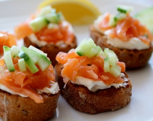 toasted Schar roll with cream cheese and smoked salmon