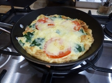 tomato and spinach omelette with melted cheese