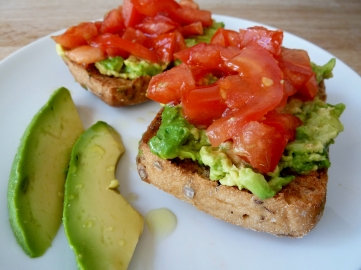 Toasted GF Schar roll with mashed avocado and chopped tomato